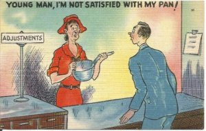 Lady Holding Pan at Return Counter Young Man, I'm Not Satisfied With MyPan!