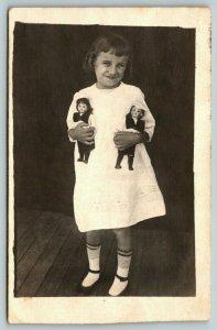 RPPC~Smiling Girl in White~Striped Socks~Dolls w/Uniforms~White Hats~Nurse? 1914
