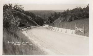 RP: TURKEY POINT , Ontario , 1910s-1930s ; Looking Down the hill, road
