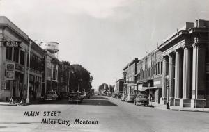 Miles City MT~Main Street~Hotel Ingram~Cafe~Bakery~Water Tower~1950s Cars~RPPC