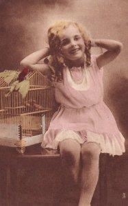 Birdie Mine, 1900-10s; Blonde Little Girl  & Parrot on bird cage, TUCK #423...