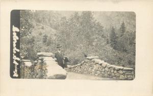 Colorado Springs Real Photo Postcard~Man Stands on Stone Bridge c1913