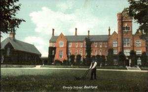 Bedford UK Man Mowing Lawn of County School c1910 Postcard