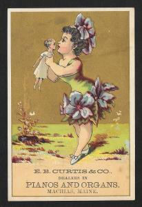 VICTORIAN TRADE CARD Curtis & Co Pianos & Organs Fancy Dressed Lady with Doll