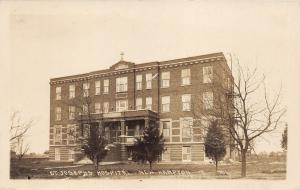 New Hampton Iowa~St Josephs Hospital~Evergreen & Bare Trees~c1920s RPPC-Postcard