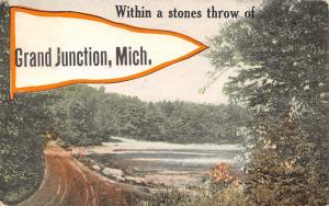With A Stones Throw of Grand Junction Michigan~Road Past Lake~1915 Pennant PC