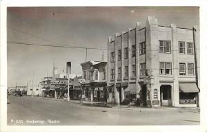 c1940 RPPC Postcard P-1632, Anchorage AK Street Scene Drugstore Sears etc Posted