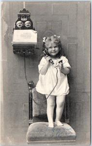 1908 NORWAY Greetings / Telephone Postcard Little Girl Standing on Chair / Phone