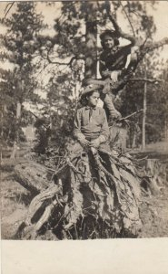 RP: Two Girl Scouts on Tree Stump , 1908
