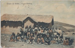 GROUP OF INDIANS -.View shows several Uru-Uru Indians posing in front of hut