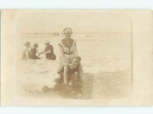 rppc 1920's RIDING PIGGYBACK AT THE BEACH AC8873