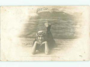 rppc 1916 WOMAN IN VINTAGE SWIMSUIT TRYING TO BE SEXY AC8150