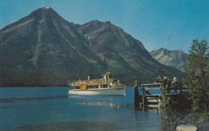 International, sightseeing launch at American end of beautiful waterton Lak...