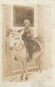 RP: Boy Riding a donkey , 00-10s