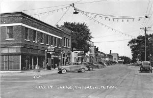 Enderlin ND Main Street Storefronts City News Stand Old Cars RPPC Postcard