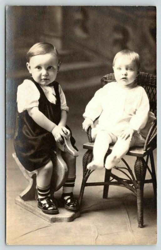 RPPC Grandma's Pets~One Rides Carved Wooden Duck~Baby Sits on Wicker Chair~c1914