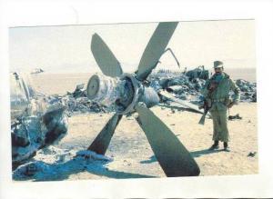 Iranian Soldier gurads US Air Force Plane Wreckage, Desert, Iran, 1981