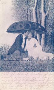 Romantic Couple Kissing Under Mushroom