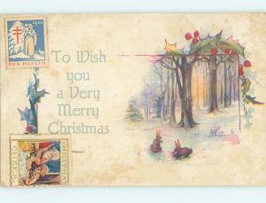 1922 Two CHRISTMAS SEAL STAMPS ON BUNNY RABBIT CHRISTMAS POSTCARD hk9202