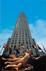RCA Building, highest building in Rockefeller Center, flags, statue, monument