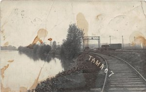 F99/ Tama Iowa RPPC Postcard 1907 Railroad Tracks River