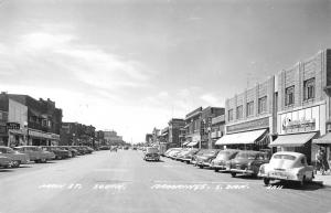 Brookings SD~Main Street South~Woolworth~Sears~City Bakery~Cafe~1940s Cars~RPPC