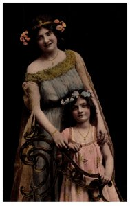 Victorian dressed Mother and Daughter
