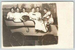 RPPC~Studio Prop Auto~Crowded w/Six Ladies in White~1 Backwards on Hood~c1910 PC