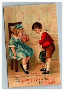 Vintage 1912 Ellen Clapsaddle Easter Postcard Boy Gives Girl Flowers Glitter