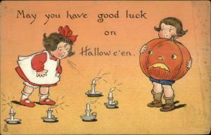 Halloween Little Girl Blowing Out Candles Boy w/ JOL TUCK 188 c1910 Postcard
