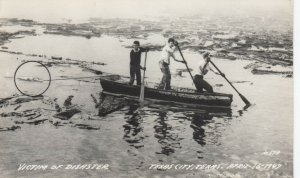 RP:TEXAS CITY , Texas , 1930-40s ; Disaster Victim Being towed behind boat