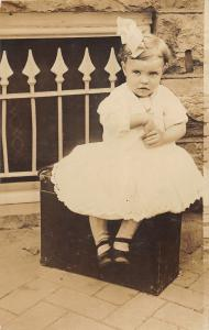 F37/ Interesting Real Photo RPPC Postcard Pretty Girl Suitcase Bow Dress c1910