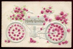 dc1382 - Hearty GREETINGS Postcard 1910s Embossed Roses & Motorcycle