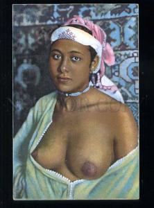 213638 Semi-nude Arabian girl in HAREM carpet Vintage postcard