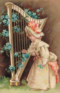 Girl playing Harp Embossed Postcard 03.43