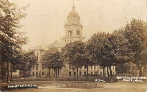 Ithaca Michigan~Caretaker Mows Grass on the Courthouse Lawn~Flower Bed~RPPC 1911