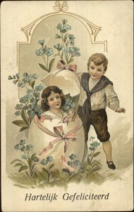 Easter - Boy Find Girl in Giant Egg Shell c1910 Postcard