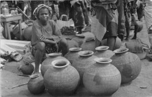 B86488 the pot seller a market scene types folklore  nigeria africa