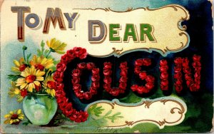 VINTAGE GREETING POSTCARD TO MY DEAR COUSIN EMBOSSED FLOWERS POSTED 1909