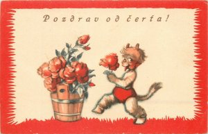 Holidays Christmas little KRAMPUS Devil holding rose early greetings postcard
