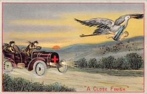 Greetings Automobile Race Stork with Baby A Close Finish Postcard JD228148