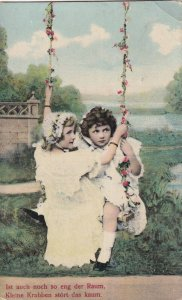 Two little girls wearing bonnets sitting on a swing with flower ropes, PU-1906