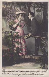 Hand-colored, Man speaking to woman holding parasol and bouquet of flowers, P...