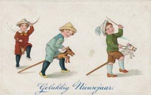 NEW YEAR : Children on hobby horses, 1900-10s