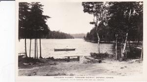 RP: ONTARIO, Canada, 1930s; Man in row boat, Ferguson Hwy, Temagami District