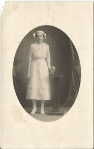 Old Photograph of young Dutch Woman holding an intricate box Vintage Postcard