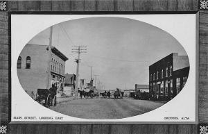 Okotoks Alberta Main Street Horse & Wagons Storefronts in 1911 RPPC Postcard