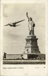 NEW YORK, N.Y., Clipper Airplane passing Statue of Liberty (1950s) RPPC (2)