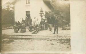 Social history Postcard railway station workers group picture