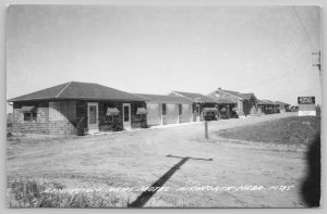 Ainsworth Nebraska~Tiled Showers Promise on Sign~Remington Arms Motel~ RPPC 1950